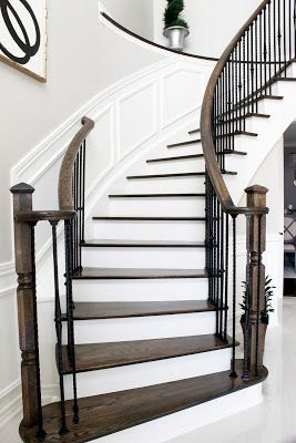 AM Dolce Vita: Painted Staircase Reveal, foyer painted staircase, curved staircase with wrought iron spindles, foyer abstract art, DIY abstract art, wall wainscoting, Troy Lighting Sausalito lantern, Benjamin Moore Revere Pewter, foyer porcelain Crema Marfil tiles