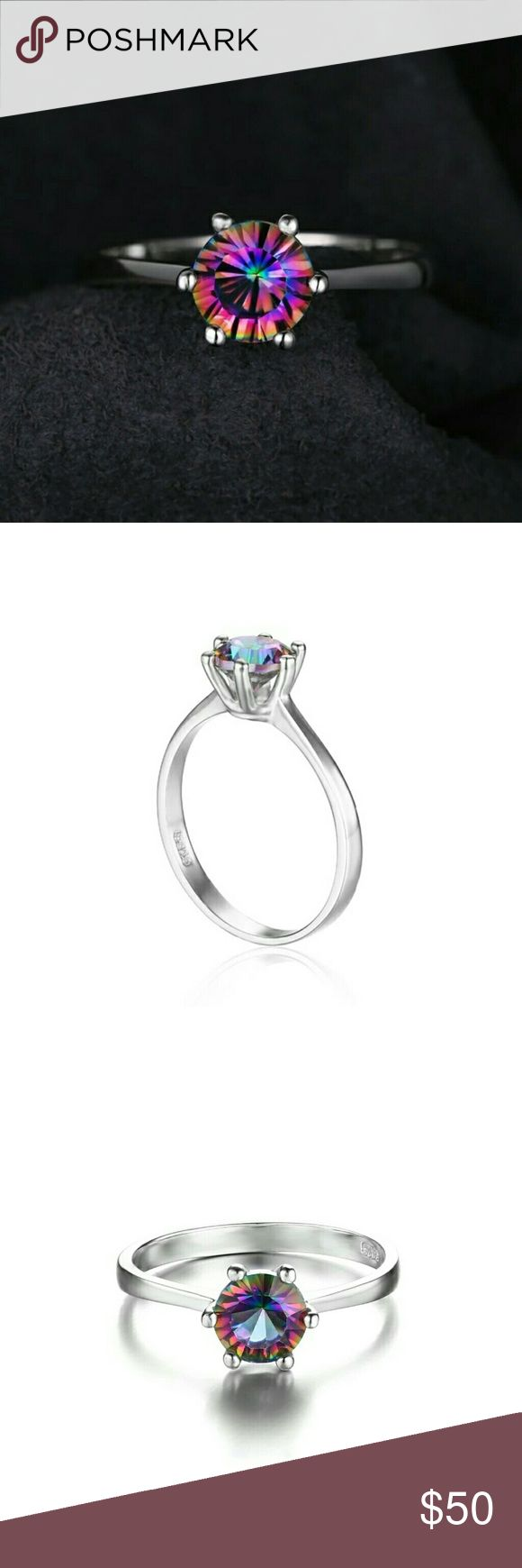 This Just In! 1 Ct Mystic Fire Topaz Ring in S925 She's just arrived today and yes, she's just as beautiful as everything I get from my jewelry store!  1ctw Mystic fire Topaz with a 6 prong setting in solid Sterling Silver. Purchaser is welcome to the COA for their own purpose. JP Jewelry Rings