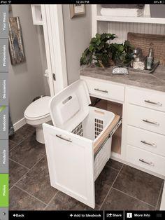 Bathroom idea- hamper storage. Love this idea!  Hamper hidden, but right where it should be--in the bathroom!