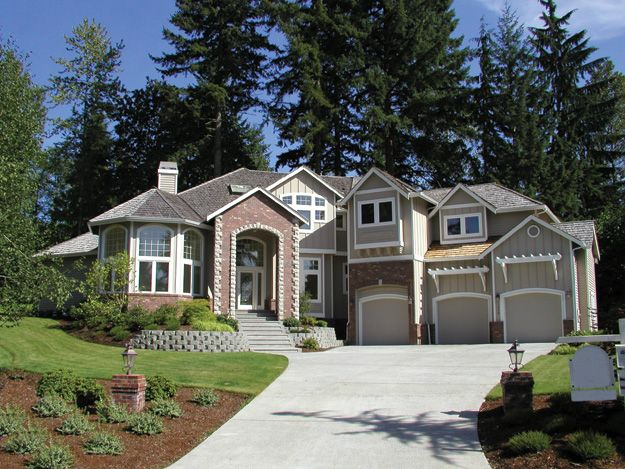 Covered Entry Leads Into A Large Two Story Foyer With Curved Staircase In  This 4 Bedroom Craftsman Home.