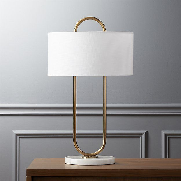 Shop warner table lamp.   Brilliant in its minimalism.  Brushed bronze design by Ceci Thompson floats a white linen shade on one continuous sleek swoop.  White marble base adds a little extra luxe.  Learn about  on our blog.