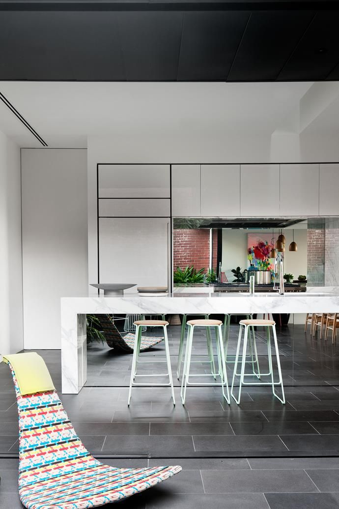 The mirrored kitchen island amplifies the sense of space and brings the outside in.   Photo: Shannon McGrath   Story: Belle