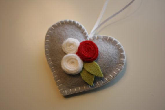 simple little heart with great touches of color. Looks like wound strips of wool felt forming each rose.