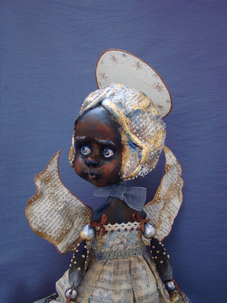 Guarding angel doll - Dark skin guarding angel - Afro-angel poseable doll - Art interior doll with wings - Unique gift for doll collectors by DreamTrainOfDolls on Etsy https://www.etsy.com/listing/257482884/guarding-angel-doll-dark-skin-guarding