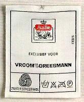 Textieletiket met lichtgrijze ondergrond d.m.v. zwarte lijnen verdeeld in drie vakken. In het grootste (bovenste) het AaBe logo van rendier met slede, waarop wollen dekens zijn gestapeld in zwart-wit m.u.v. lettergedeelte (rood/wit), eronder de tekst 'exclusief voor Vroom en Dreesman' en het nr. '130115'. Linksonder een wolmerk met 'zuiver scheerwol' (zw-w) en rechtsonder wasvoorschriftsymbolen.
