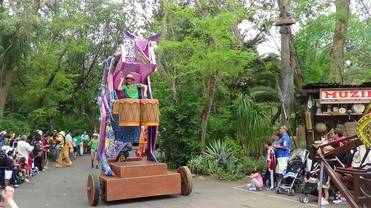 #AnimalKingdomParade This massive magenta kangaroo hops down the street at Animal Kingdom's Jammin' Jungle Parade. A cast member tucked inside her pouch bangs some drums to help keep time with the parade's wild jungle beat!