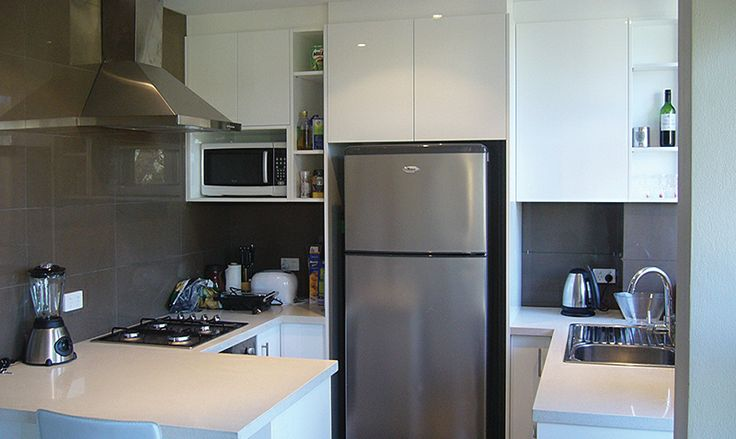 Maximising kitchen space in an apartment is essential. This is a simple, yet functional design.