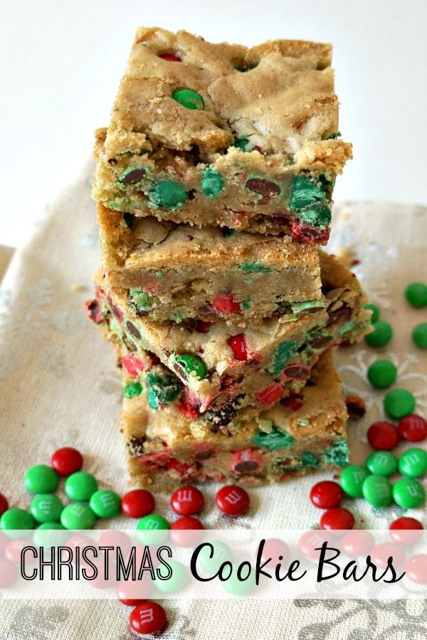 This easy Christmas Cookie Bars recipe is made with Holiday M&M's and Red and Green Nestle Toll House morsels. They're so fun and so festive!