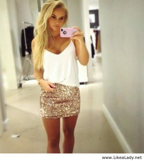Sequin skirt and white tank.