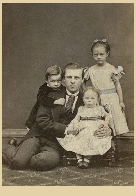 +~+~ Antique Photograph ~+~+  Beautiful portrait of a father and his three children.  The informal pose is unusual for that time period.  And yet it shows the love of this father who doesn't mind getting down on the floor with his little ones.  I love the way the boy is hugging his father from behind and the way the father is leaning into his girls, it displays such tenderness. Glasgow, Scotland.  ca. 1867