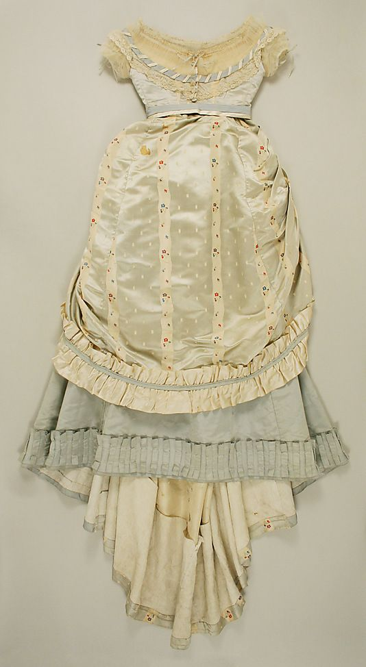Silk ensemble with evening bodice (front), by Dupret, French, ca. 1867. I don't like using silk because they basically cook the poor silkworms to death (kill them with heat) after they have finished producing for them. However, I am all for using vintage (which this is) or recycled silk, and I like this outfit. I think I'd prefer a diff. color, though, because I am so pale. I prefer contrast.
