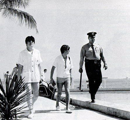 """george-harrison-marwa-blues: """"February 1964- John & Ringo with security stroll down a beach in Miami. What an incredible photo!!! """""""