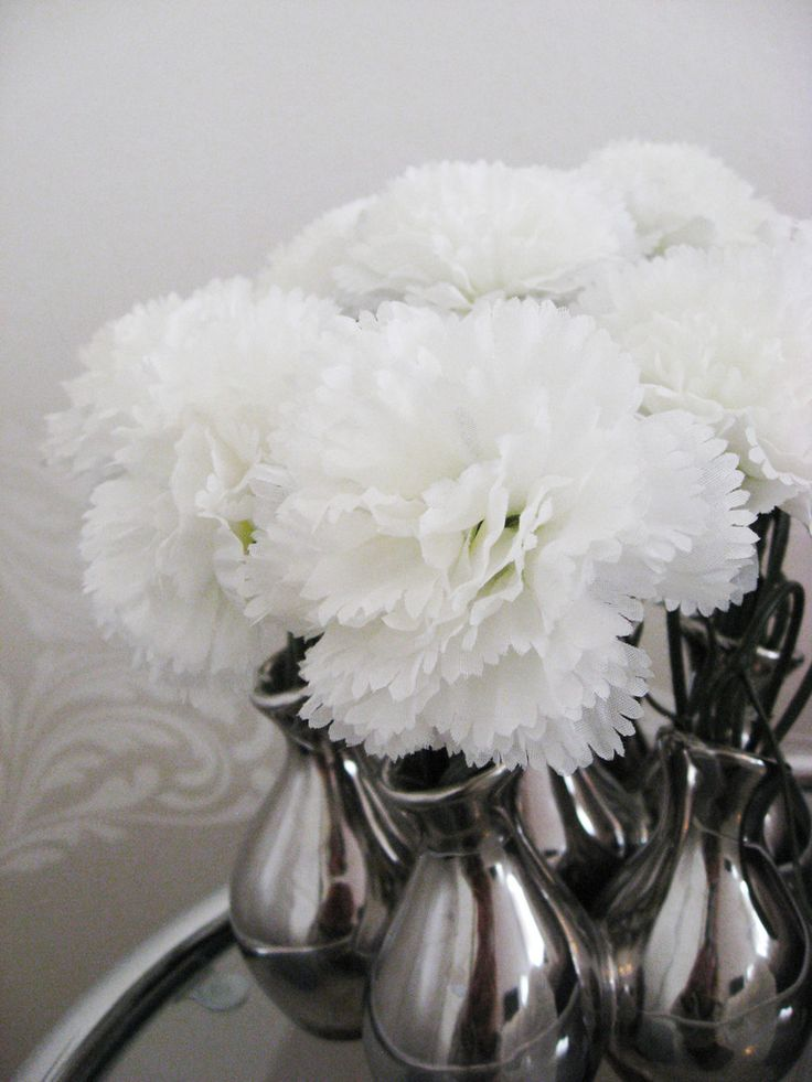 Fake white gillyflowers on my bedroom sidetable
