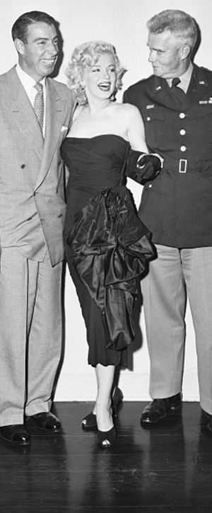 Marilyn Monroe and Joe DiMaggio at a party for Bob Hope at his home in California, December 13, 1953.