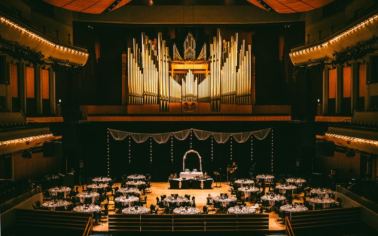 A wedding reception on the stage of Jack Singer Concert Hall, Arts Commons, Calgary   Photo courtesy of Salt Co. Photography