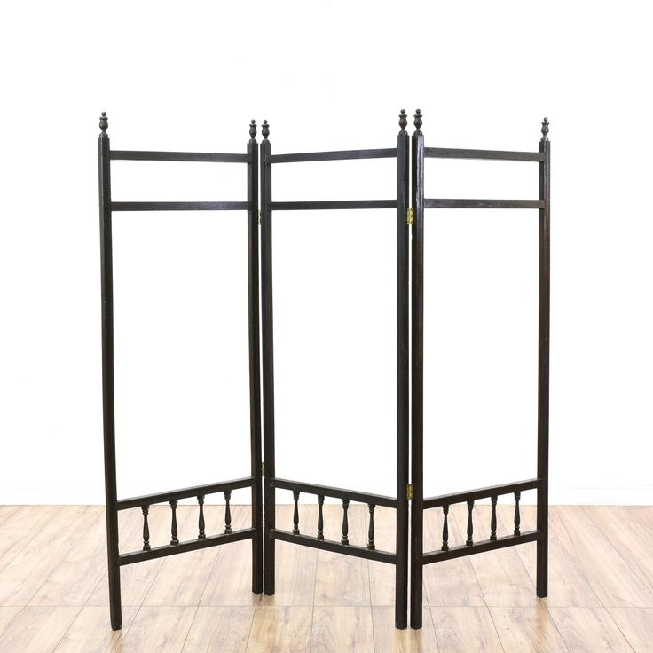 This victorian room divider is featured in a solid wood with a glossy black painted finish. This screen has 3 folding panels, finial tops and carved spindle rail details. Great for hanging art and blankets!  #americantraditional #decor #art&screens #sandiegovintage #vintagefurniture