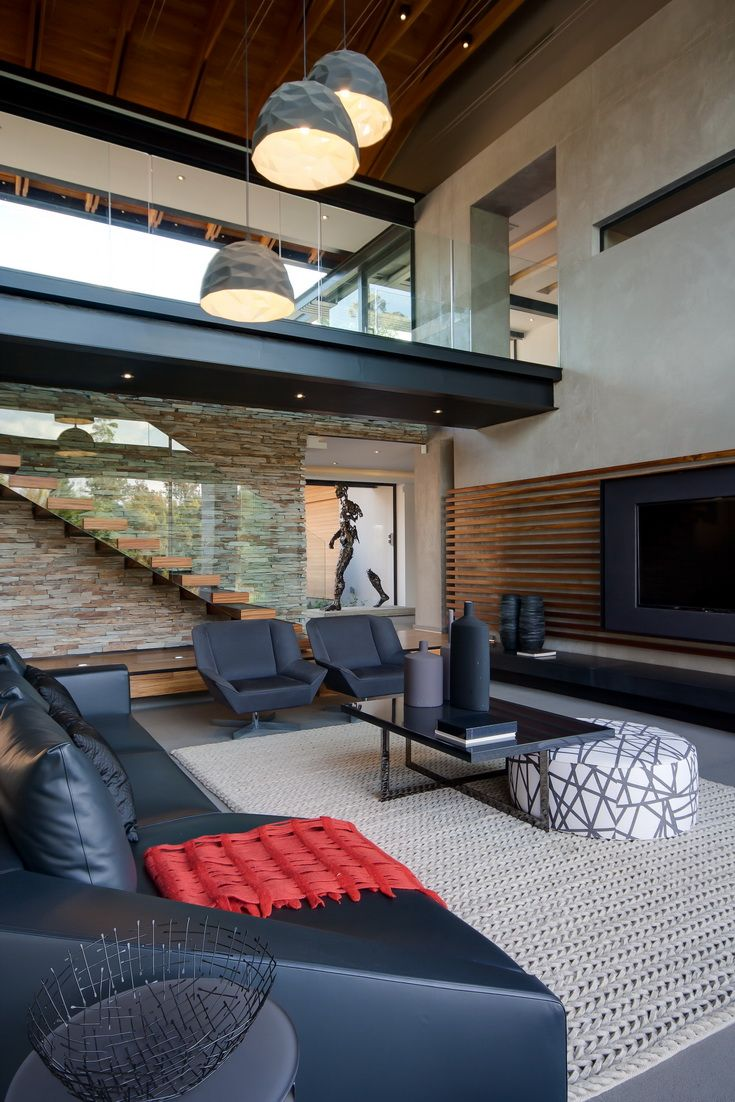 A bit too much black, but like the mix of wood, glass, back stones and give gray