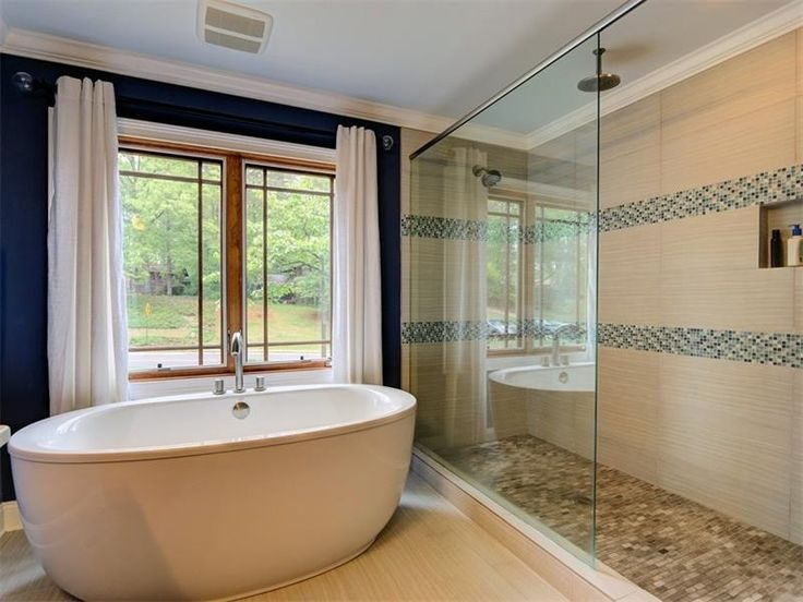 Contemporary Master Bathroom with travertine floors, Freestanding, Master bathroom, Crown molding, Rain shower, High ceiling
