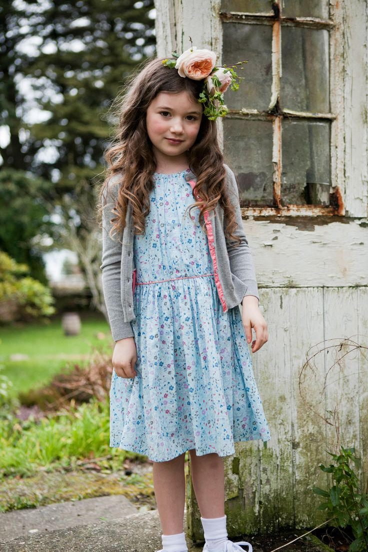 Blue floral dress with elasticated waist worn with grey buttoned cardigan, all Leigh Tucker Willow