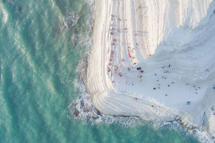 "DECEMBER 1, 2017SOFT ROCK  This white cliff in Sicily is called ""Scala dei Turchi,"" or the Turkish Steps. Natural erosion has softened the limestone and marl cliff, and the aerial view of visitors reminds Your Shot photographer Placido Faranda of ""a big meringue covered with sprinkles.""  PHOTOGRAPH BY PLACIDO FARANDA,"