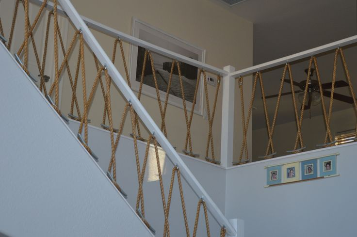 """Nautical Stairway Rebulit the bannisters with 5/8"""" Manila rope, 8"""" boat cleats and eye hooks."""