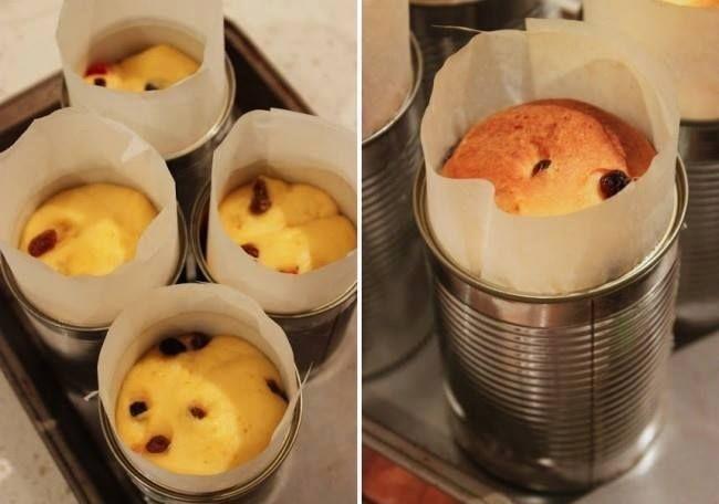 Ingredientes: Você vai precisar de: , - 8 latinhas  , - Papel manteiga. ,  , Para a massa: , - 400g de farinha, , - 75g de açúcar, , - 45g de fermento, , - 2 ovos, , - 80ml de leite, , - 125g de manteiga, , - 200g de uvas passas sem sementes, , - 1 colher de café de essência de Panettone ou laranja.