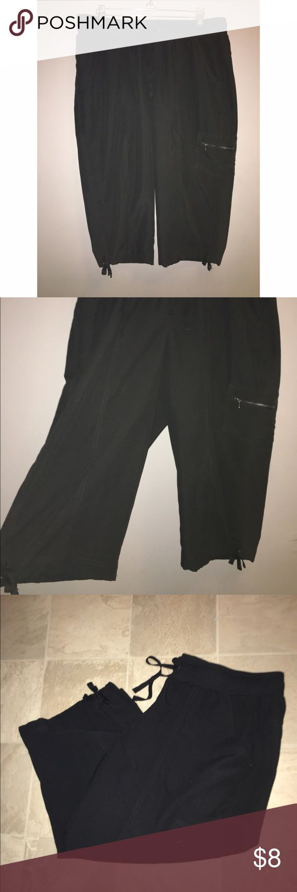Ladies Tek Gear Nylon Crop Pants Sz Large Nylon Tek Gear black crop pants. Size Large. Ties on bottom of pants. Please ask any and all questions prior to purchase. tek gear Pants Track Pants & Joggers