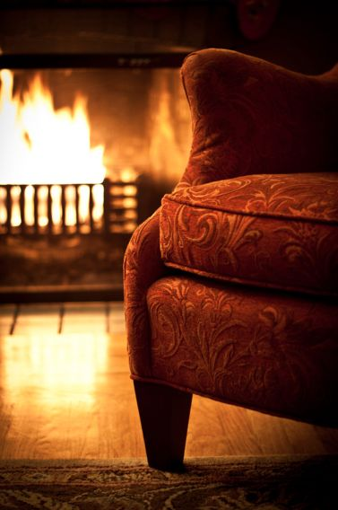 Wingbacked armchair and open fire