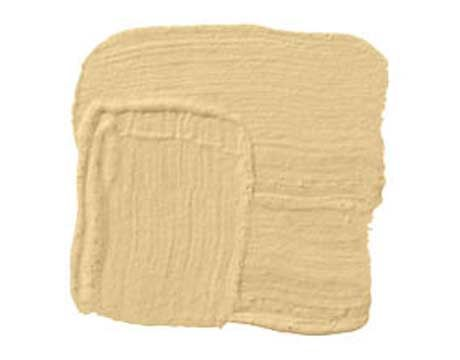 "SHERWIN-WILLIAMS HUMBLE GOLD SW6380: ""Humble Gold has such warmth on a gray winter day. It just snuggles into you. There are so many colors in it — gold, yellow, pink, red. That little blush brings out the rosiness in your cheeks when you come in from the cold. It's not a sharp color. That's what makes it cozy and inviting. So it welcomes you and makes you look beautiful at the same time."