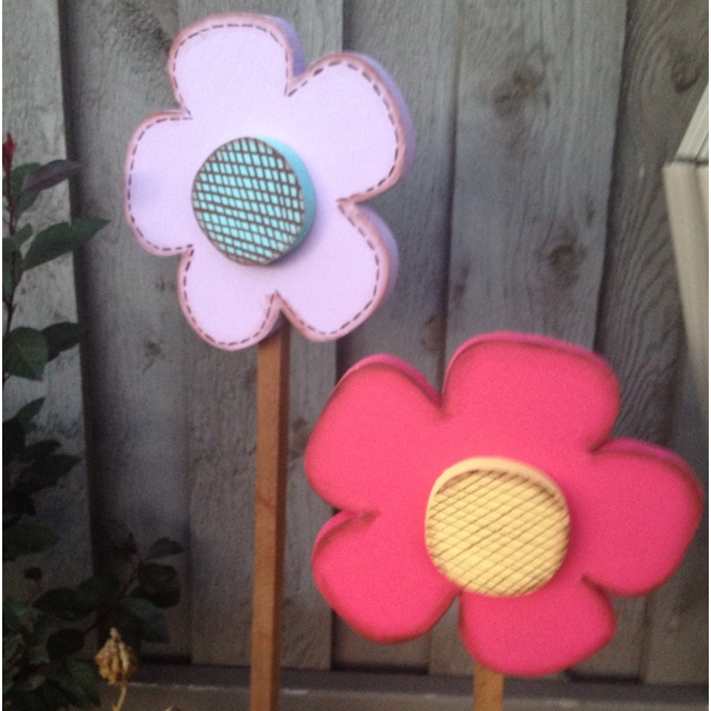 Wooden flowers for the flower bed @Chris Cote Brown Steele  -- same idea, different design.