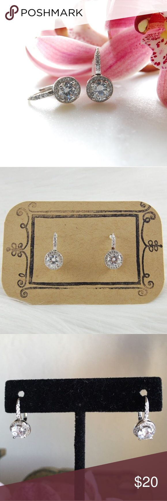 "CZ Earrings | French Clip Cute and dainty cubic zirconia earrings. Single CZ is .75 karats/6mm and is surrounded by additional CZsz French clip so it is for pierced ears but encloses completely. Measures 3/4"" long. Includes box. Price firm unless bundled. {E3039}    Instagram: @bringingupsuns Jewelry Earrings"