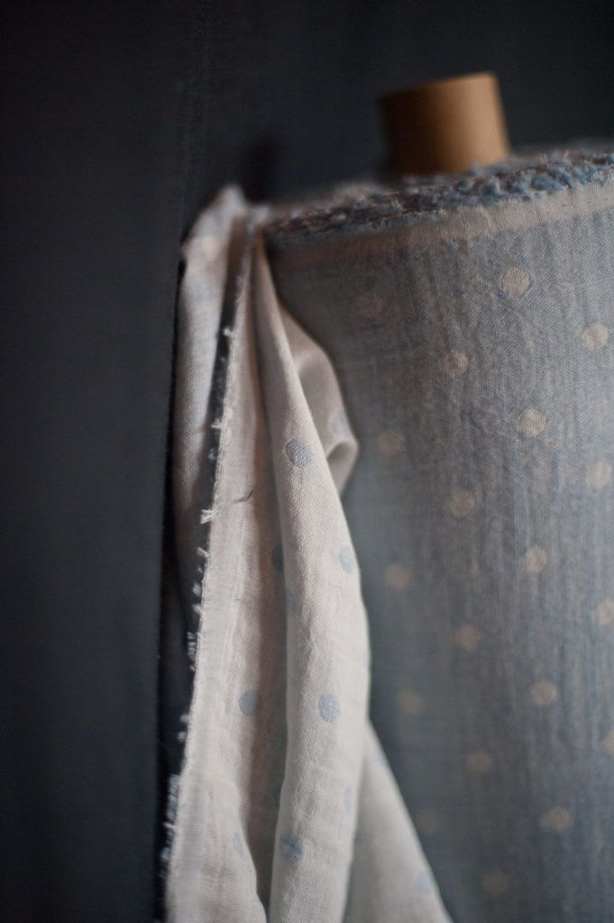 A Japanese double gauze organic cotton. Soft white muslin one side and pale blue cotton spots on the reverse. 112cm wide.116g/m. Wash at 40 degrees, do not tumble dry. Twin Spot Blueis suitable for the following patterns in our Workbook: Bantam and Heron.