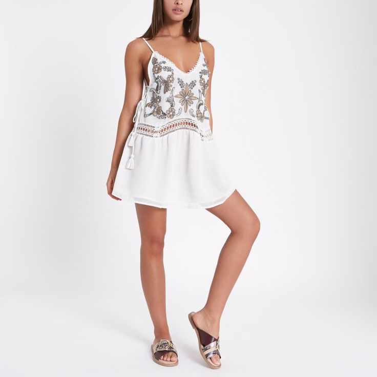 Woven fabric Floral bead and sequin embellishment Drop waist Cami shoulder straps Lace trim and waist insert Lace-up side detail Beach cover up Our model wears a UK 8 and is 175cm/5'9'' tall