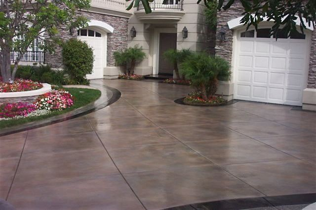 Allied Outdoor Solutions Stained Concrete Driveway In 2020 Concrete Patio Stained Concrete Driveway Concrete Decor