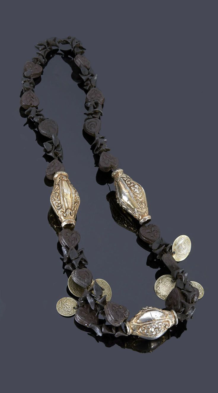Tunisia   Necklace; silver and scented paste beads in the form of hearts and triangles
