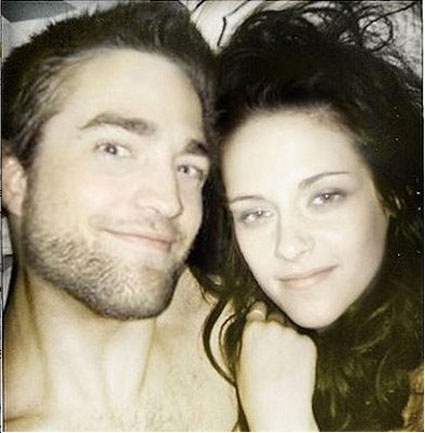 Robert Pattinson and Kristen Stewart being all smiley while in bed together...?