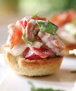 Bite Sized BLTs - While a sandwich is the perfect home for the classic BLT, this variation mixes all the ingredients together and serves them up in neat little toast cups.