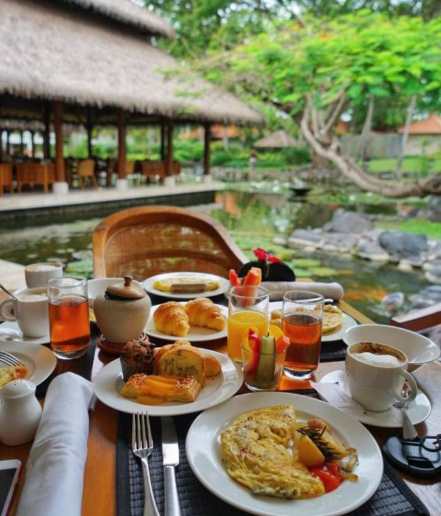 Saturday brunch overlooking the lush lagoon at Grand Hyatt Bali. The perfect combination of magnificent fountains, carvings and clear fresh water pools.