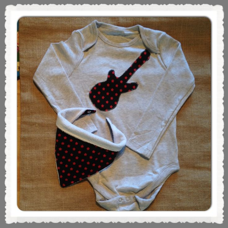 Black with red stars. Rock and roll guitar applique on pale grey cotton bodysuit.