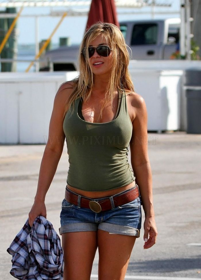 Carmen Electra in jeans shorts                                                                                                                                                     More