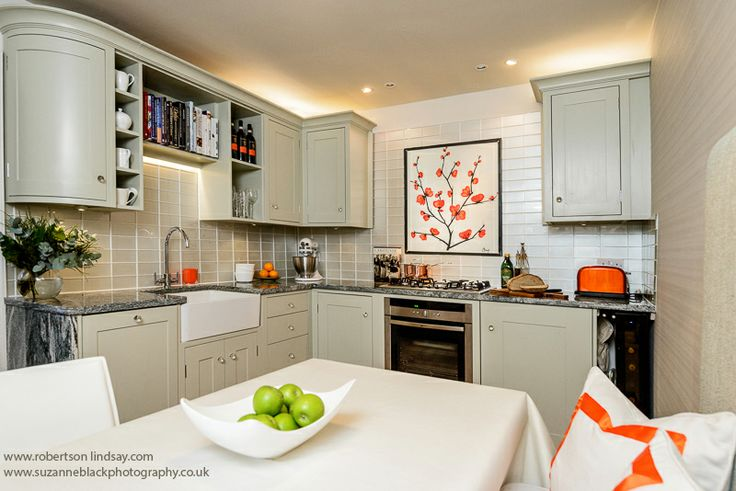 Kitchen design idea. Orange painting. Belfast sink, Granite worktop. Sally Homan. Robertson Lindsay Interiors