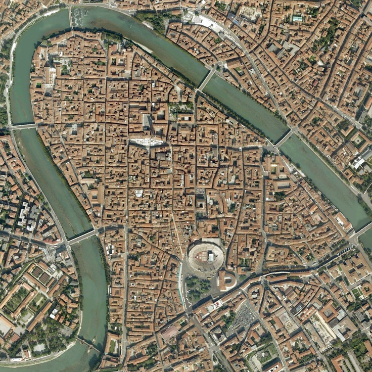 The old part of town... The river Adige forms an S ... a natural barrier fortified by the old town walls, towers and castles. Verona, Italy