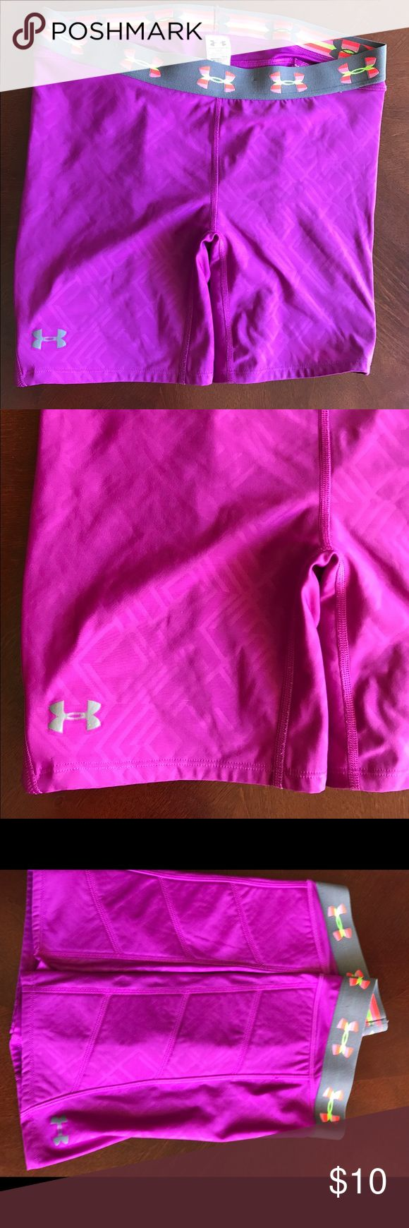 Under Armour pink women's L purple bike shorts Under Armour pink women's L purple bike shorts. Padded. Great very gently worn condition. Under Armour Shorts