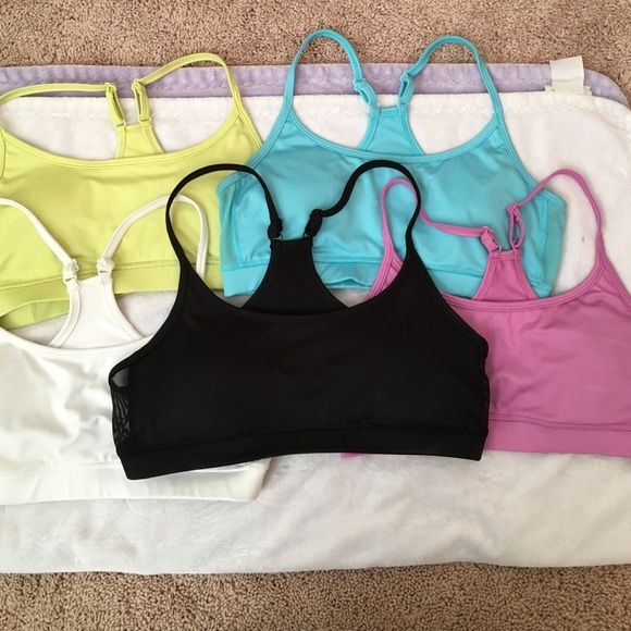 Aerie cross back sports bras Aerie lightly (removable) padded sports bras sold as a group of 5. Super comfortable!!!! Blue, yellow, purple, white and black. aerie Intimates & Sleepwear Bras