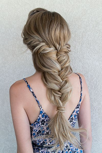 Boho brides, you'll swoon over this loosely braided fishtail.