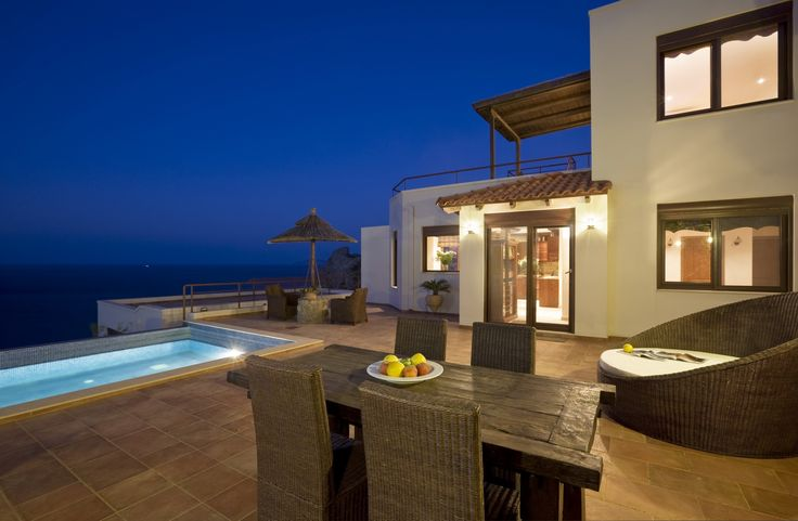 VIP Autumn Villa to rent in Elounda, Crete island. The interiors are fashioned from the perfect blending of contemporary design with typical Cretan style. Villa 's floor plan includes three bedrooms (one on each floor), a living room, dining