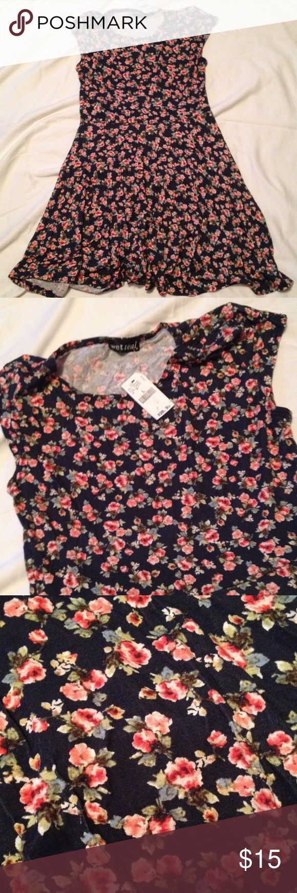 NWT floral mini dress by Wet Seal NWT.  Beautiful dress.  Think spring! Wet Seal Dresses Mini