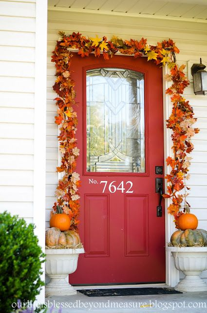 This simple and pretty autumn front door will work all fall long, through Halloween and until Thanksgiving.  (I love the house numbers on the door, too!)