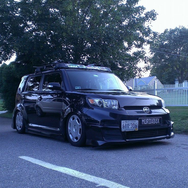 slammed black Scion xB with body kit thule rack out of