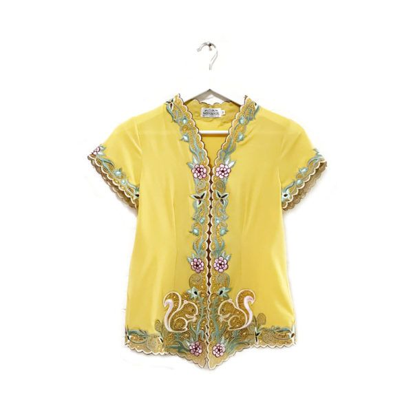 Candy Squirrel Classic Yellow Mustard IDR 875.000  This is a Pre-Order     Estimated Work Days : 10 – 14 working days (excluding Saturdays, Sundays & Public Holidays)    Candy Squirrel Hand Embroidery Contemporary Kebaya Classic    Length of Kebaya : (Front) approx. 70 cm / (Side) approx. 56 cm    Material used : Textured Chiffon / Hand Embroidery    Note: Inner Wear is not included with the Kebaya